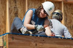 Carpenter works on building roof of new home Royalty Free Stock Images