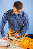 Carpenter works with carpenter vise Stock Photography