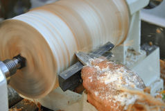 Carpenter works with chisel. On lathe Stock Photo