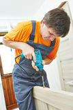 Carpenter works with drill Royalty Free Stock Photos