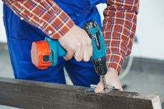 Carpenter works with drill Royalty Free Stock Photo