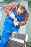 Carpenter works with drill Stock Photos