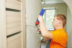 Carpenter works with foam Royalty Free Stock Photo