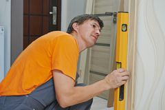 Carpenter works with level Stock Image