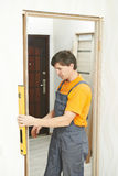 Carpenter works with level Stock Photography