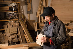 Carpenter works with wood in the workshop Royalty Free Stock Photo