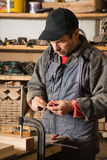 Carpenter works with wood in the workshop Royalty Free Stock Images