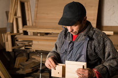 Carpenter works with wood in the workshop Stock Photo