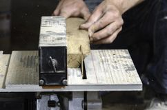 A carpenter works on woodworking the machine tool. Royalty Free Stock Photo