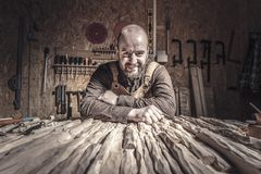 Carpenter in workshop. Portrait of smiling carpenter in a workshop stock photo