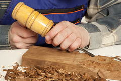 Carpenter. Young craftsman in uniform working at carpentry Royalty Free Stock Photos