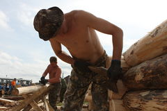 Carpenters. Building a traditional wooden house in Siberia. Tomsk. Russia Royalty Free Stock Image