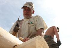 Carpenters. Russia. Tomsk. Building a traditional wooden house in Siberia Stock Photo