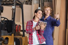 Carpenters With Digital Tablet Planning In Stock Image