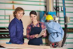 Carpenters With Digital Tablet In Workshop Royalty Free Stock Photos
