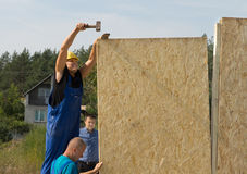 Carpenters erecting wall panels on a new build Stock Image