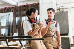 Carpenters having break from their work. In workshop Royalty Free Stock Photo