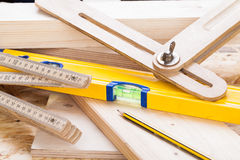Carpenters level, ruler and right angle Royalty Free Stock Photography
