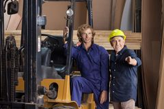 Carpenters Looking Away By Forktruck Stock Photos