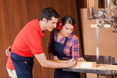 Carpenters Measuring Wood In Workshop Royalty Free Stock Photography