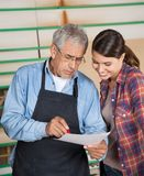 Carpenters Over Document In Workshop Royalty Free Stock Photo