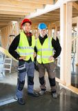 Carpenters In Protective Clothing At Construction Site Royalty Free Stock Photo