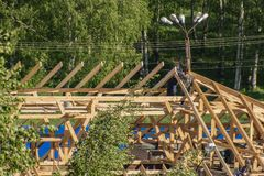 Carpenters on the roof. Carpenters install the roof frame of the house royalty free stock photo