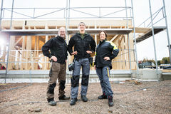 Carpenters Standing With Hands On Hips At Construction Site Royalty Free Stock Images