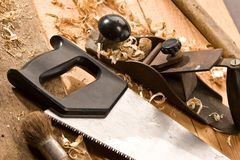 Carpenters tool. Set of carpenters tool on the wood and shavings Stock Photos