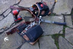 Carpenters Tool Belt. Laying on the patio waiting for its owner to put it back on stock photos