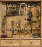 Carpenters tools in a wooden cabinet Stock Photos