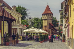 The Carpenters' Tower in Sibiu city, Romania. Unidentified people wander along the medieval defense wall and The Carpenters' Tower on 06 May, 2015 in Sibiu city Royalty Free Stock Images