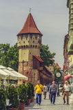 The Carpenters' Tower in Sibiu city, Romania. Unidentified tourists stroll along the medieval defense wall and The Carpenters' Tower on 06 May, 2015 in Sibiu Stock Photo