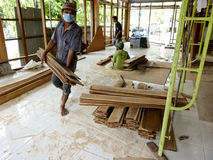 Carpenters. The carpenters were building a house in the central Java city of Solo, Indonesia Stock Image