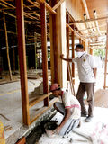 Carpenters. The carpenters were building a house in the central Java city of Solo, Indonesia Royalty Free Stock Images