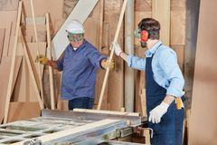 Carpenters woking in teamwork royalty free stock photo