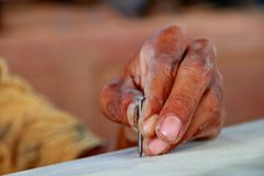 Carpenters work on woodworking machinery in carpentry shops royalty free stock images