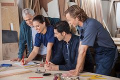 Carpenters Working On Blueprint Stock Photos