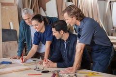 Carpenters Working On Blueprint Stock Photos