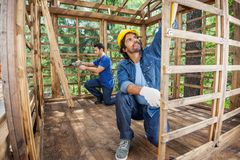 Carpenters Working At Construction Site Royalty Free Stock Photos
