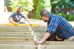 Carpenters Working At Construction Site Royalty Free Stock Images