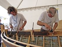 Carpenters are working on the old wooden boat restoration. Brest, France - July 14, 2008: Croatian traditional shipbuilders are working on the restoration of an Royalty Free Stock Photo