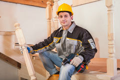 Carpentery worker sitting on ladder. Young man Stock Photography
