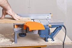 Carpentiere con l'aereo elettrico Fotografie Stock