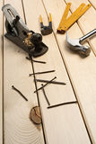 Carpentry. A carpenter's tools on wood boards Stock Image