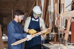 Carpentry apprentice during lesson. Of wood processing stock photos