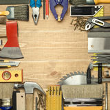 Carpentry background. Carpentry tools on a wooden board Stock Image