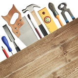 Carpentry background. Tools underneath the wood plank royalty free stock image