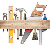 Carpentry background. Carpentry, construction hardware tools underneath the wood plank Stock Photos