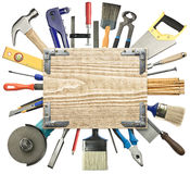 Carpentry background. Carpentry, construction background. Tools underneath the wood plank Stock Photo